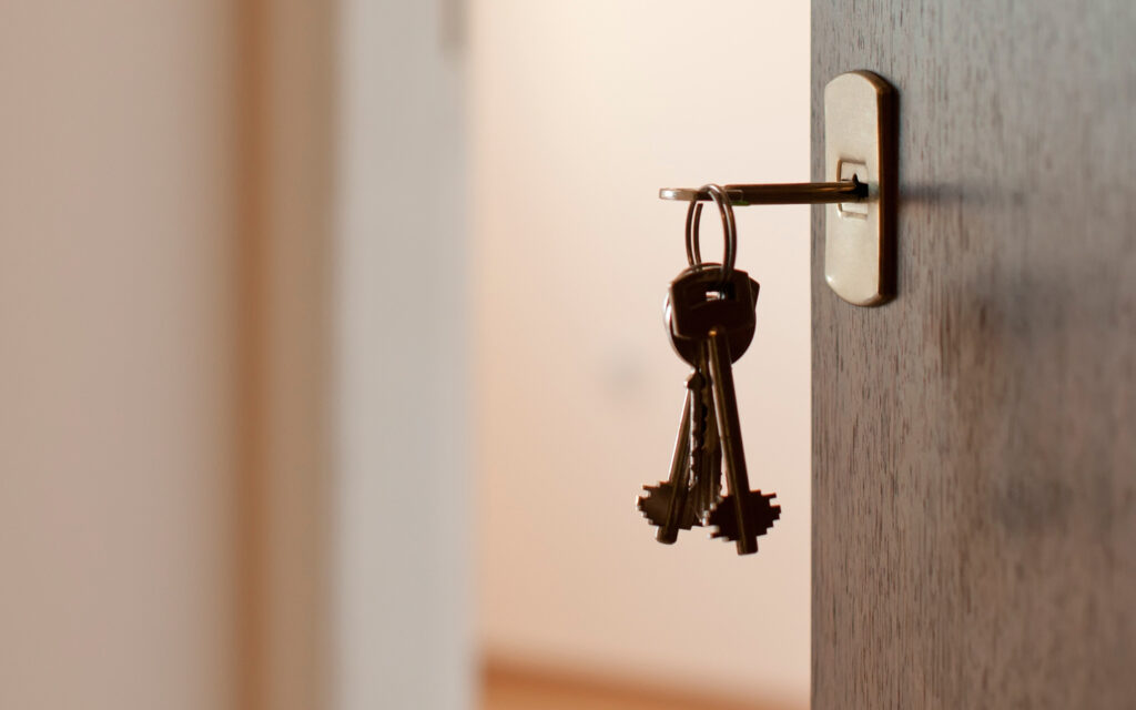 a key inserted in a keyhole of a door of a rental property managed by TESO Property Management in Ellenville