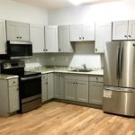 a kitchen with a big oven and a double door refrigerator of a rental property of TESO Property Management in Ellenville