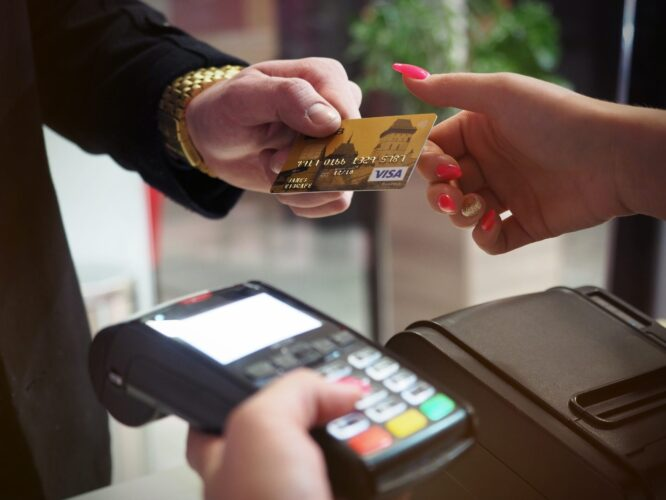 A person lending his card for credit check